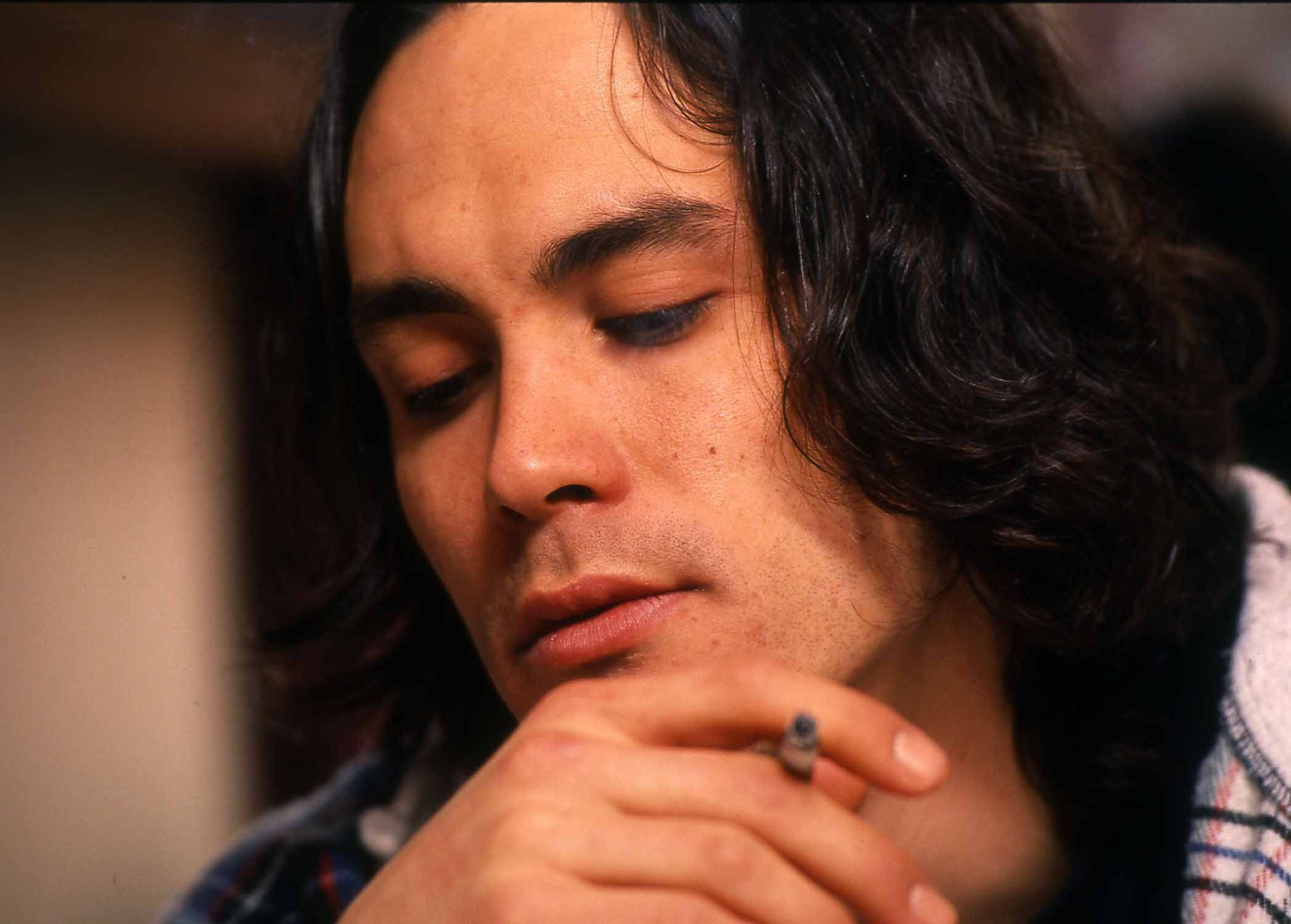 Actor Brandon Lee chain smokes cigarettes in his trailer during a late-night interview on March 23, 1993, the week before he died on the set of The Crow in Wilmington N.C. - Photo by Jamie Moncrief / Wilmington Star-News