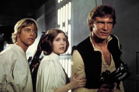 Mark Hamill, Carrie Fisher e Harrison Ford in Guerre Stellari (1977) - foto Movieplayer.it
