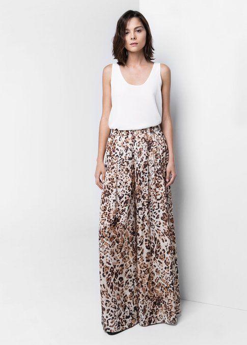 Pantaloni palazzo con fantasia leopardata di Mango