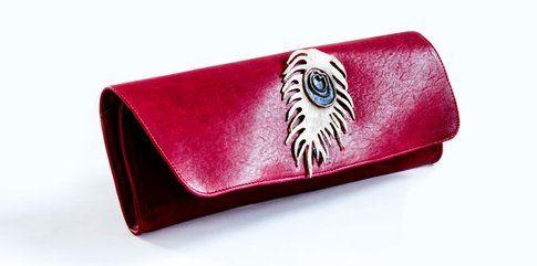 Pochette in pelle con occhio in bronzo applicato