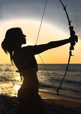 Woman_with_a_bow_in_backlight