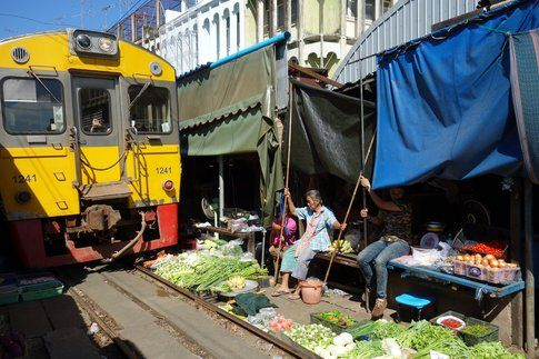 Maeklong railway market by M-Louis