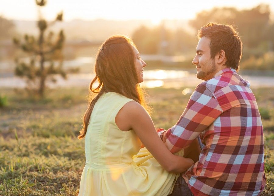 Young couple in love outdoor in the sunlight sunset.
