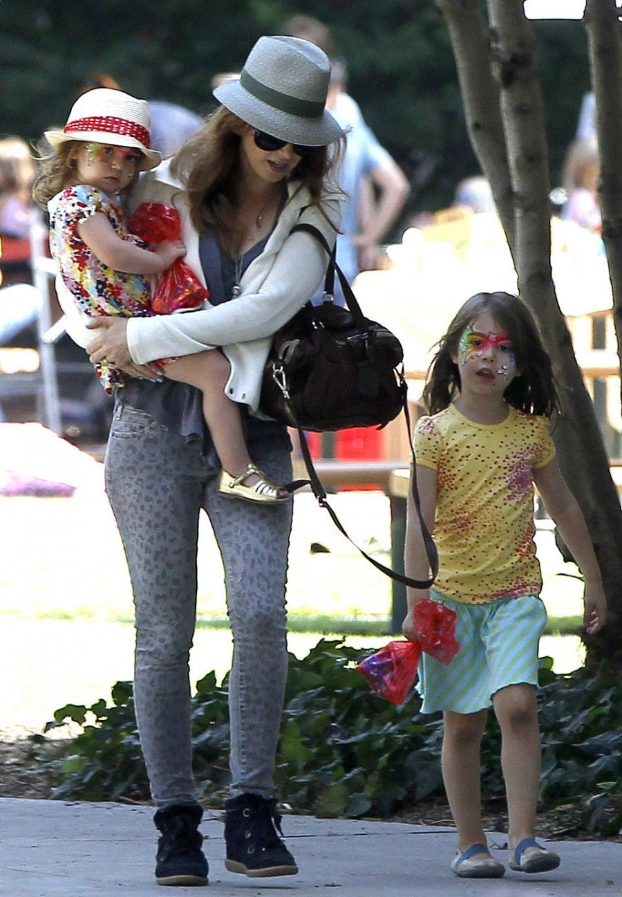 Semi-Exclusive... Isla Fisher and Sacha Baron Cohen Take the Girls to a Birthday Party