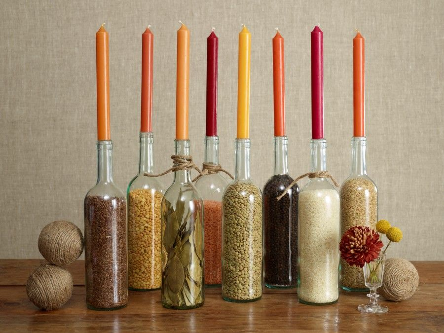 Fill glass bottles with grains and spices for a colorful arrangement.