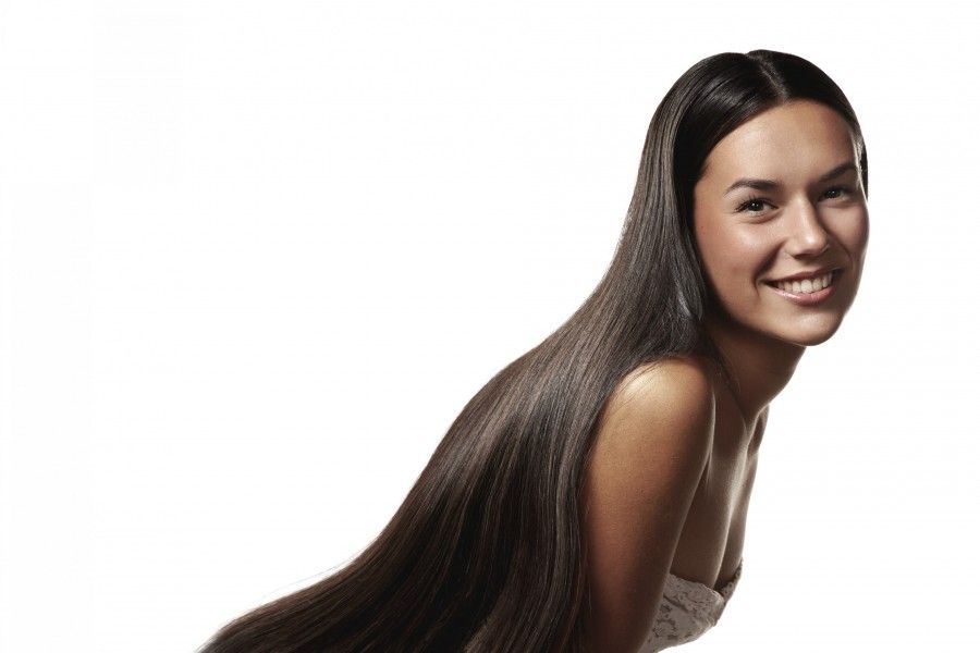 Woman with long straight strong hair --- Image by © pinkypills/Corbis