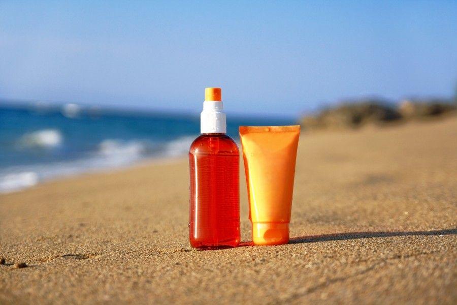 Tubes with sun protection on beach of Atlantic ocean