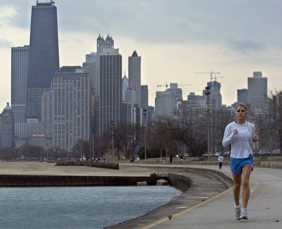 1-7-2008----A record-breaking high temperature brought out joggers in spring attire Monday afternoon. This woman is jogging along the lakefront near Fullerton. Sun-Times photo by Tom Cruze