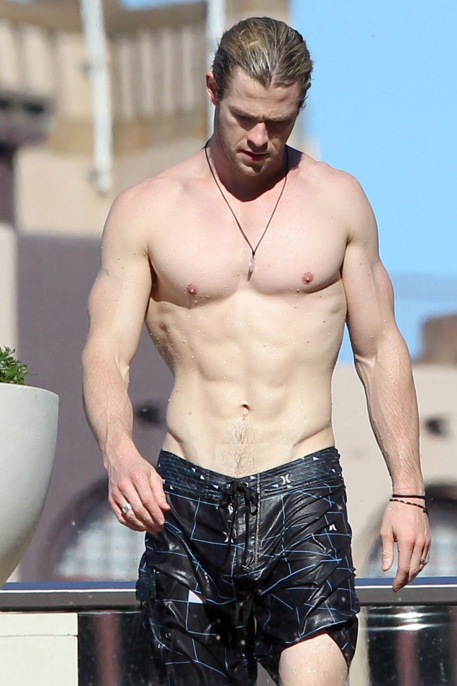 Chris Hemsworth shows off his ripped body as he chills by his hotel pool. Pictured: Chris Hemsworth Ref: SPL407263  180612   Picture by: Blue Wasp/Grey Wasp/Splash News Splash News and Pictures Los Angeles:310-821-2666 New York:212-619-2666 London:870-934-2666 photodesk@splashnews.com