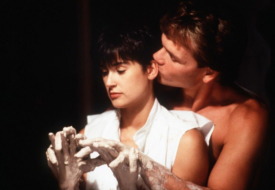 "FILE - In this image released by Paramount Pictures, Demi Moore, left, and Patrick Swayze are shown in a scene from ""Ghost.""  Swayze's publicist Annett Wolf says the 57-year-old ""Dirty Dancing"" actor died Monday, Sept. 14, 2009, after a nearly two-year battle with pancreatic cancer. (AP Photo/Paramount Pictures, file) ** NO SALES **"