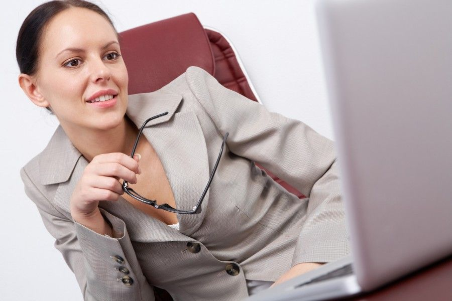 Portrait of a successful businesswoman looking at laptop screen in office