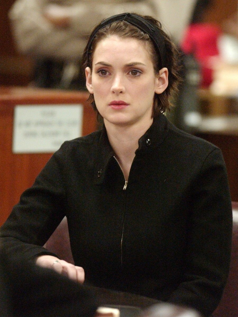 Actress Winona Ryder reacts in court during her sentencing hearing for shoplifting at the Beverly Hills Municipal Court on December 6, 2002 in Beverly Hills, California. The 31 year-old actress was sentenced to three years probation, 480 hours of community service for shoplifting from Saks Fifth Avenue, ordere