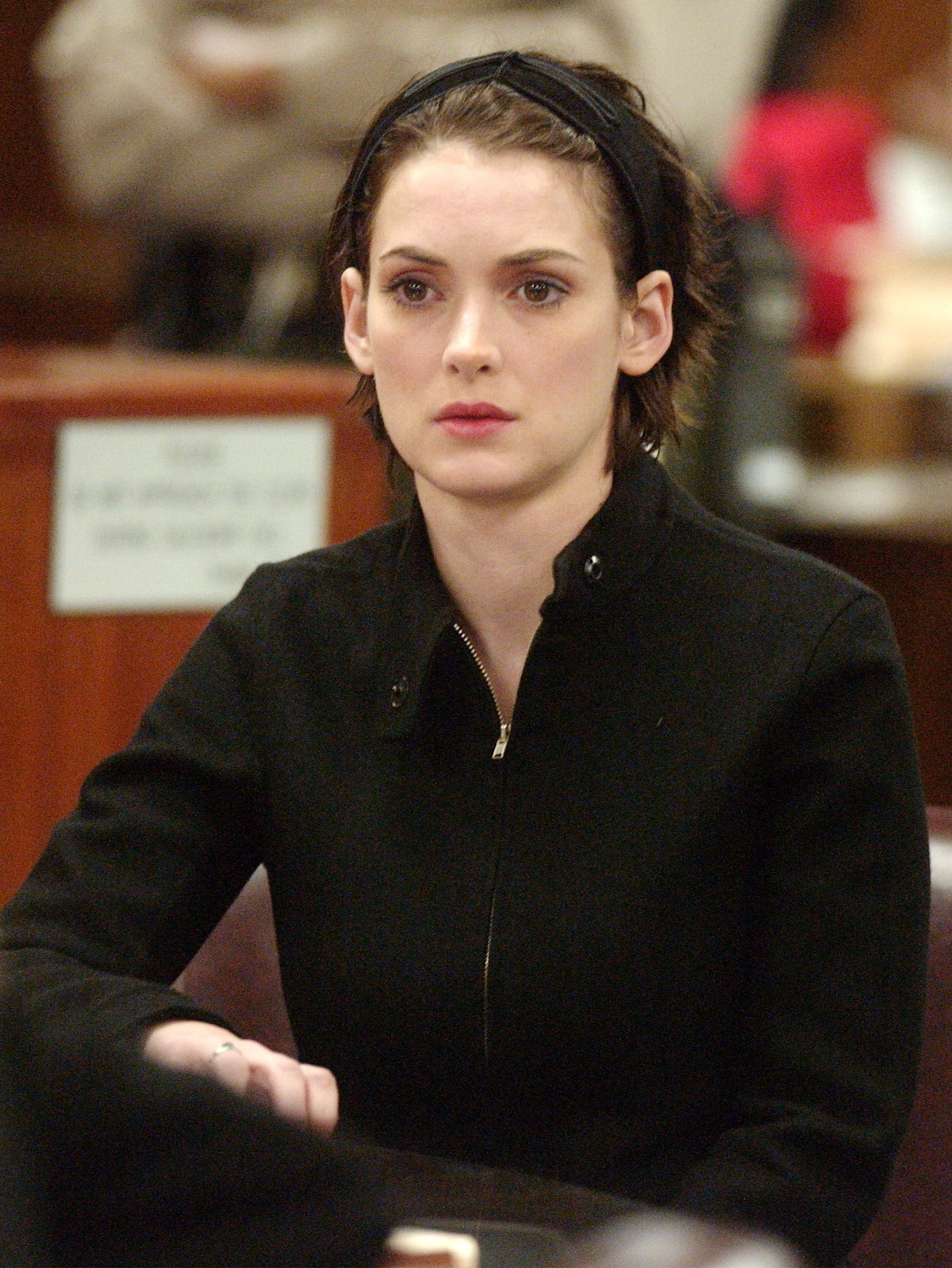 BEVERLY HILLS, CA - DECEMBER 6:  Actress Winona Ryder reacts in court during her sentencing hearing for shoplifting at the Beverly Hills Municipal Court on December 6, 2002 in Beverly Hills, California. The 31 year-old actress was sentenced to three years probation, 480 hours of community service for shoplifting from Saks Fifth Avenue, ordered to pay more than $11,300 in fines and ordered to take drug and psychological counseling. (Photo by Steve Grayson-Pool/Getty Images)