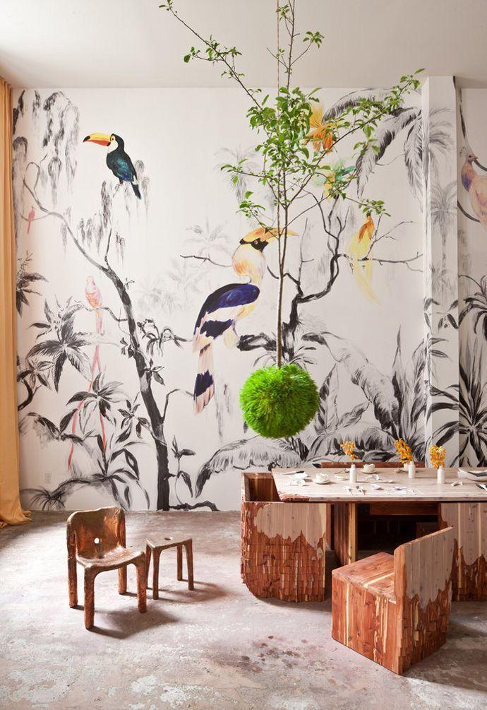 uccelli esotici in sala da pranzo