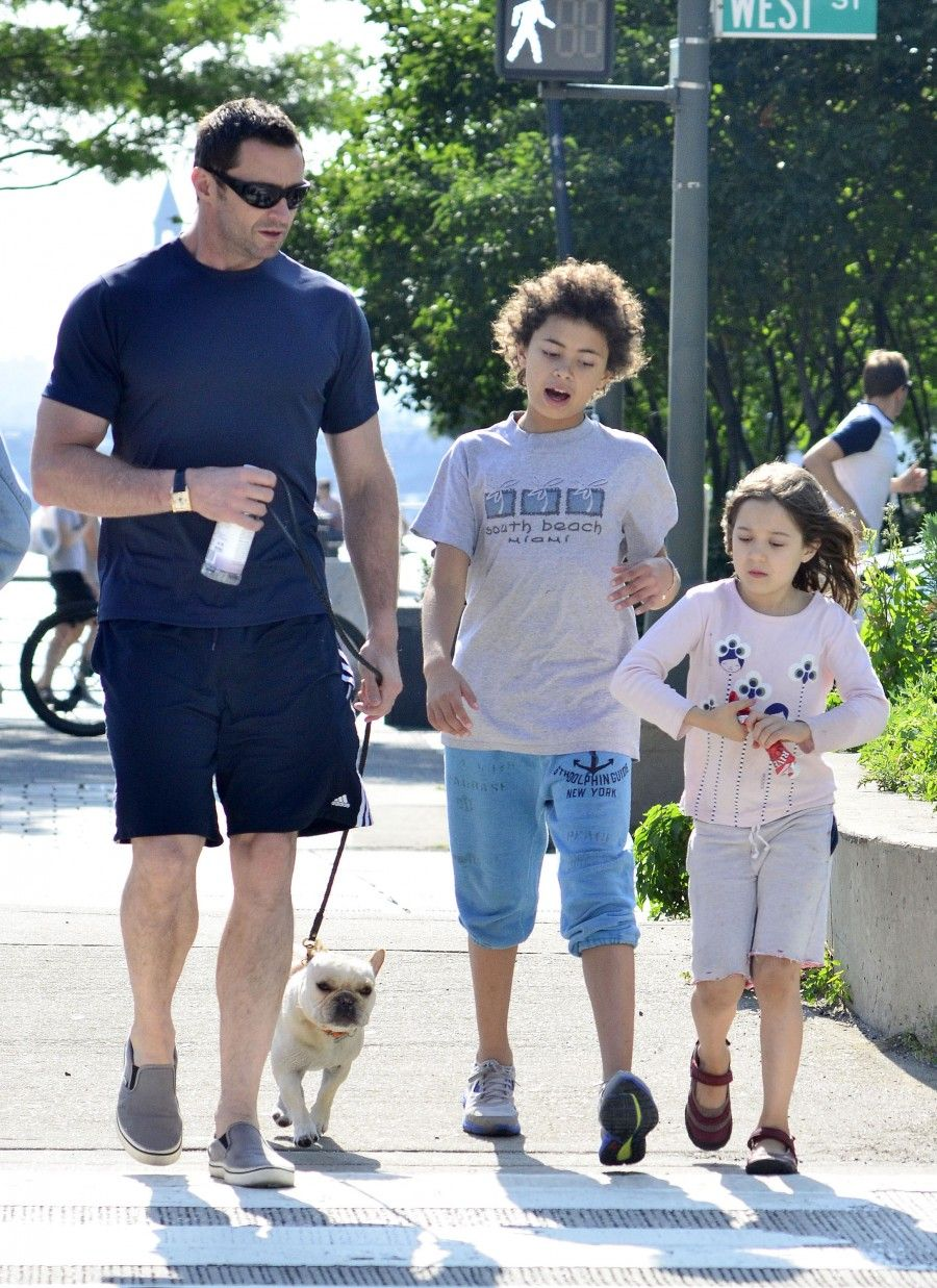 Actor Hugh Jackman was spotted enjoying Father's Day with his two kids, Ava and Oscar Jackman, to the park with their dog in New York, New York on June 17, 2012.
