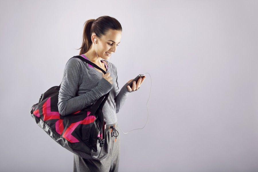 bigstock-Fitness-Woman-With-Gym-Bag-Lis-53320549