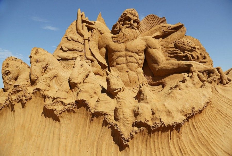"""MELBOURNE, AUSTRALIA - JANUARY 05:  A sand sculpture entitled """"Poseidon"""" carved by Martijn Rijerse and Hanneke Supply is seen at the Under the Sea sand sculpture exhibition at the Frankston waterfront on January 5, 2013 in Melbourne, Australia. Sand sculptures created by a team of Australian and international artists will be on display until April 28, 2013.  (Photo by Graham Denholm/Getty Images)"""