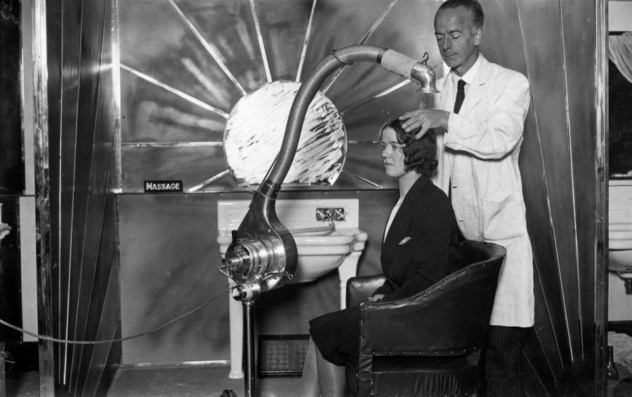 1929:  The new sunlight ultra-modern cubicle for hairdressing on show at the Hairdressing Fair of Fashion at London's White City.  (Photo by Puttnam /Topical Press Agency/Getty Images)