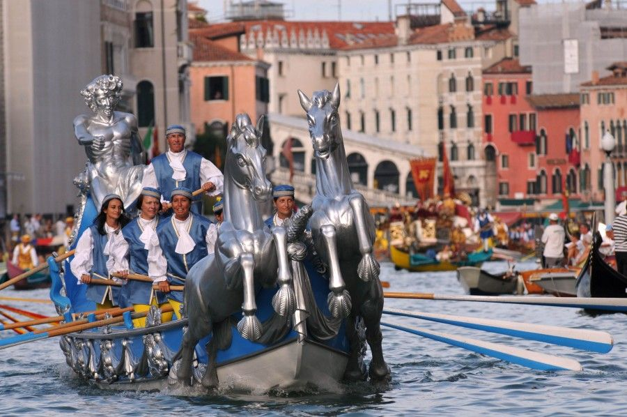 People wearing traditional costumes cruise along the Grand Canal in Venice on September 2, 2012 during a historical regatta.    AFP PHOTO / MARCO SABADIN