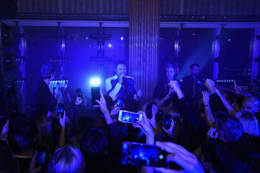 NEW YORK, NY - SEPTEMBER 13:  Duran Duran performs onstage at the new Gold Collection fragrance launch hosted by Michael Kors featuring Duran Duran at Top of The Standard Hotel on September 13, 2015 in New York City.  (Photo by Larry Busacca/Getty Images for Michael Kors)