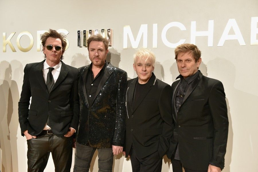 NEW YORK, NY - SEPTEMBER 13:  Members of Duran Duran John Taylor, Simon Le Bon, Nick Rhodes Roger Taylor attend  the new Gold Collection fragrance launch hosted by Michael Kors featuring Duran Duran at Top of The Standard Hotel on September 13, 2015 in New York City.  (Photo by Larry Busacca/Getty Images for Michael Kors)