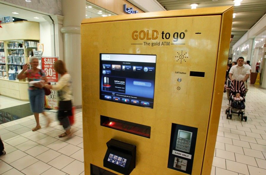 A gold-dispensing ATM machine is seen on its first day of operation at the Town Center Mall in Boca Raton, Florida December 17, 2010. The Gold to Go gold bullion vending machine was brought to the United States by PMX Gold LLC. REUTERS/Joe Skipper (UNITED STATES - Tags: BUSINESS)