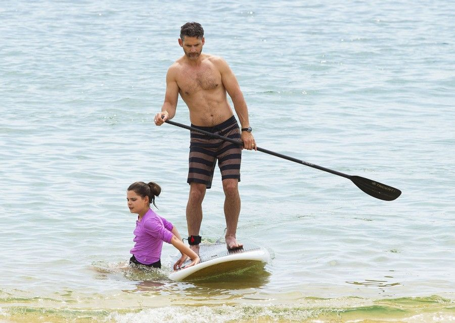 Eric Bana enjoys some quality family time on the beach in Melbourne, Australia on December 23, 2013. Eric was spotted teaching his children Sophia & Klaus all of his paddle boarding moves! FameFlynet, Inc - Beverly Hills, CA, USA - +1 (818) 307-4813 RESTRICTIONS APPLY: USA ONLY