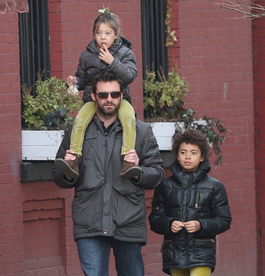"""A bearded Hugh Jackman seen out with his family in the West Village, NYC, on there way to a party. Hugh Jackman is currently growing out his beard for his upcoming role as Wolverine in """"The Wolverine"""". Pictured: Hugh Jackman,Ava,Oscar Ref: SPL228432 201110 Picture by: Mok / Splash News Splash News and Pictures Los Angeles:310-821-2666 New York: 212-619-2666 London: 870-934-2666 photodesk@splashnews.com"""