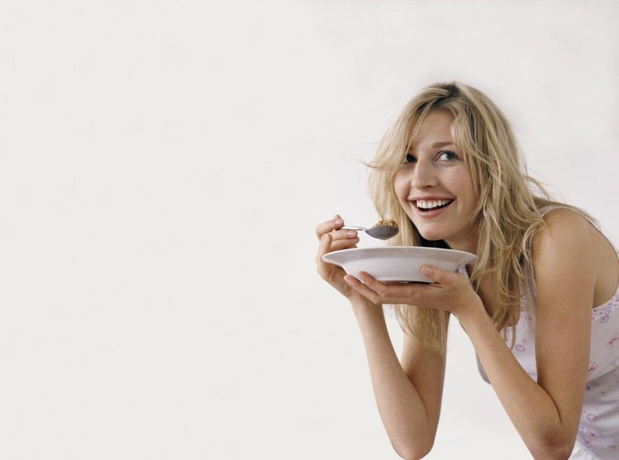 Woman Eating Cereals From a Plate