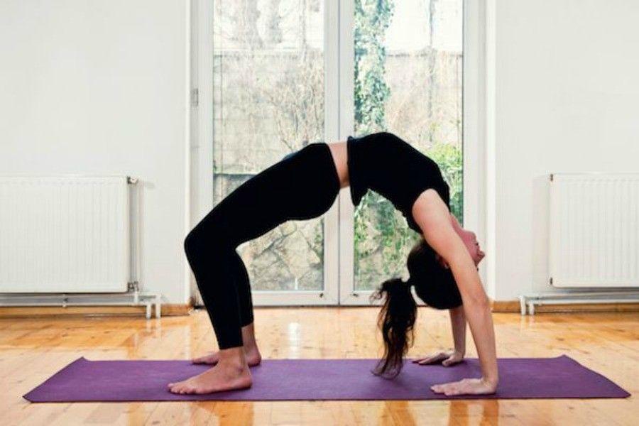 Woman doing Yoga at home - Bridge position