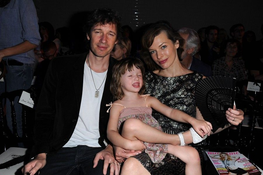 PARIS, FRANCE - JULY 06: Milla Jovovich (R), her husband Paul WS Anderson (L) and their daughter Ever Gabo attend the Jean Paul Gaultier Haute Couture Fall/Winter 2011/2012 show as part of Paris Fashion Week on July 6, 2011 in Paris, France. (Photo by Dominique Charriau/WireImage)