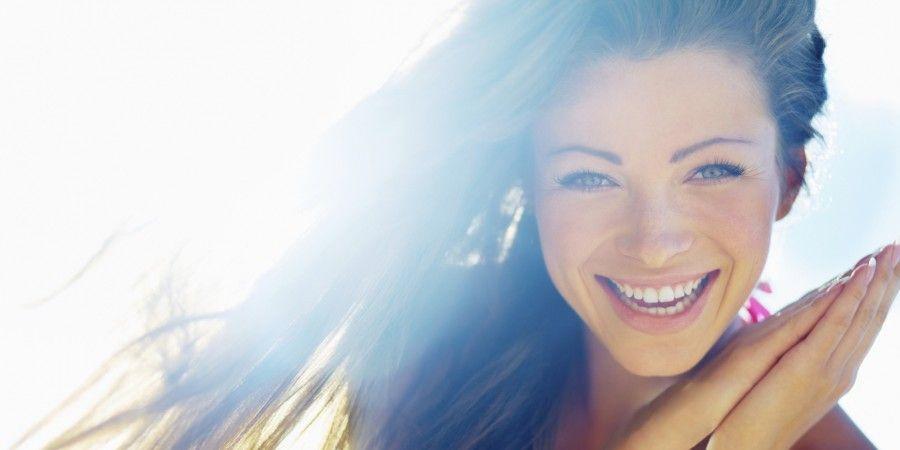 Closeup of a beautiful smiling young woman