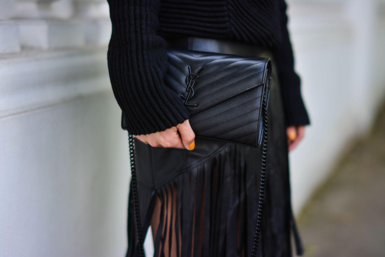 EJSTYLE-Emma-Hill-wears-River-Island-faux-leather-fringe-tassel-skirt-Romwe-black-jumper-YSL-quilted-envelope-clutch-bag-all-black-outfit