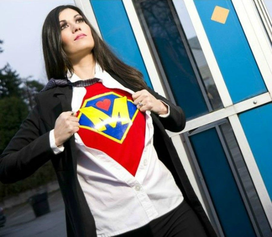 Super Megan the Super Mother comes out of the phone booth to fight fear.