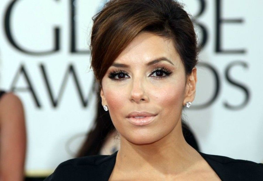 Actress Eva Longoria arrives on the red carpet for the 68th annual Golden Globe awards at the Beverly Hilton Hotel in Beverly Hills, California, on January 16, 2011. AFP PHOTO/Valerie MACON (Photo credit should read VALERIE MACON/AFP/Getty Images)