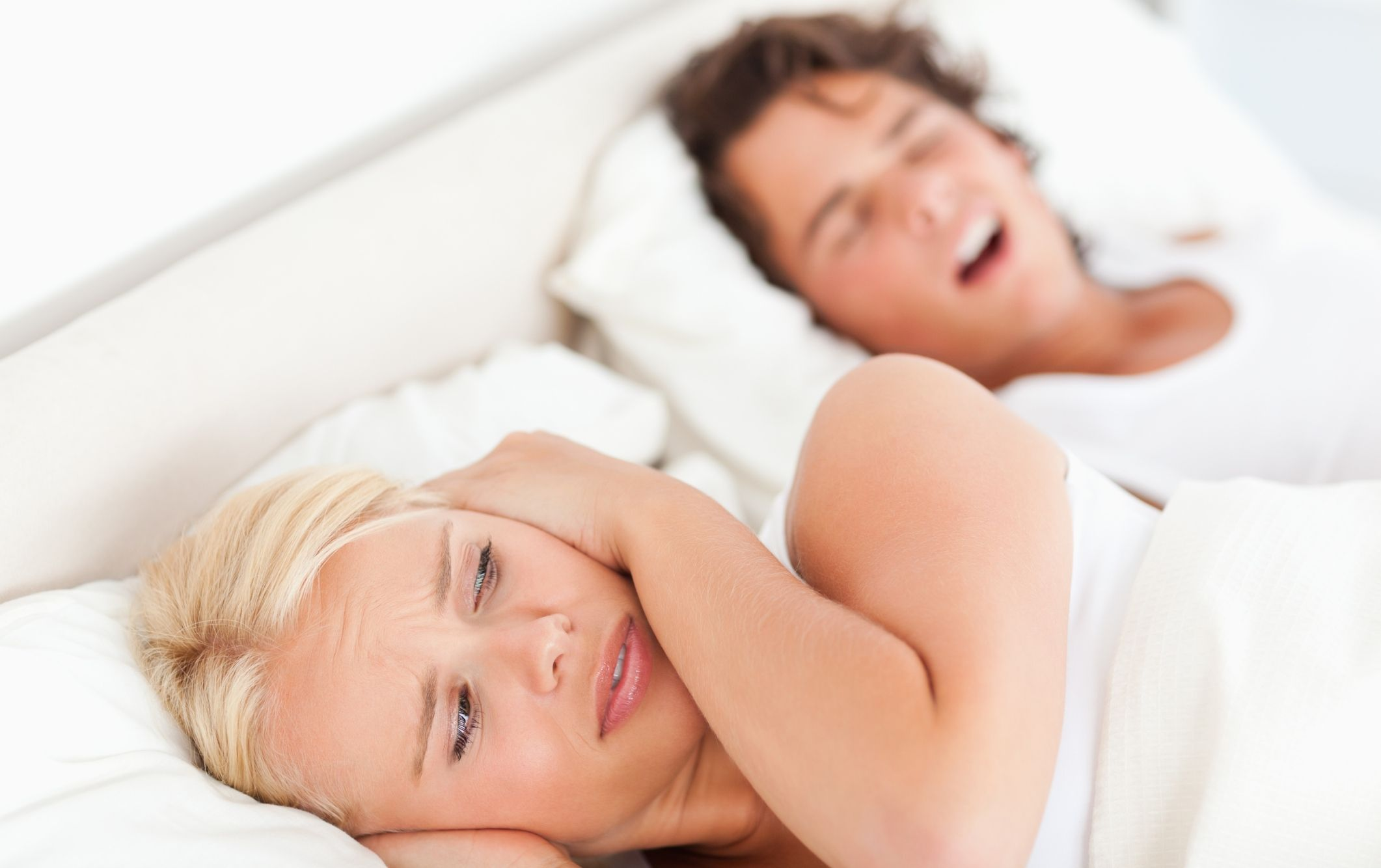 Annoyed woman awaken by her fiance's snoring