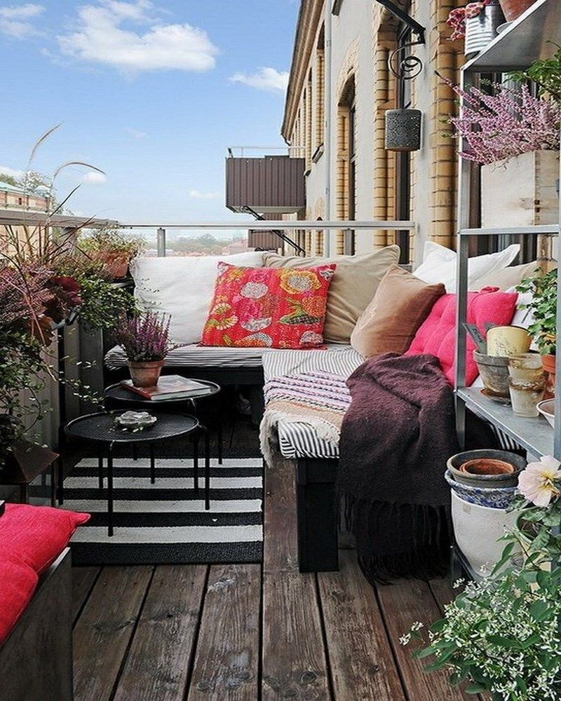 Balcony-Chair-Ideas-with-Plain-Throw-Pillows-on-Wooden-Balcony-Flooring