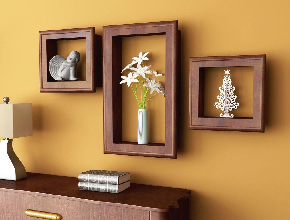 6 idee per appendere quadri e decorare una parete bigodino for Mensole per quadri