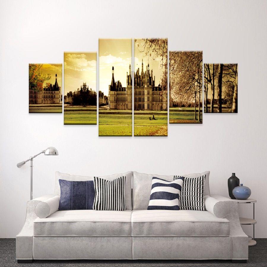 6 idee per appendere quadri e decorare una parete bigodino - Idee per decorare una stanza ...