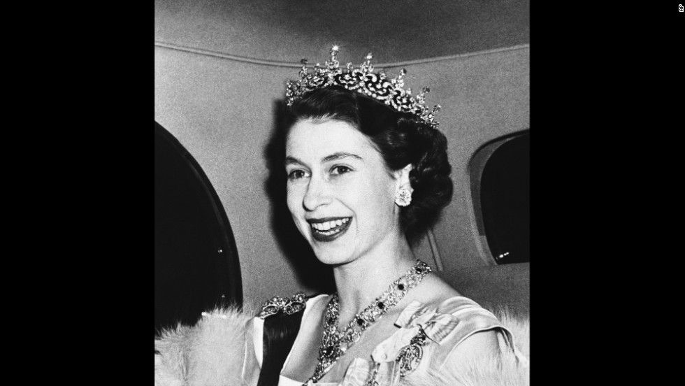 Princess Elizabeth smiles broadly as she arrives at the French Embassy in London's Kensington Palace Gardens, on Mar. 8, 1950 to attend a state banquet tendered by French President and Madame Vincent Auriol. (AP Photo)