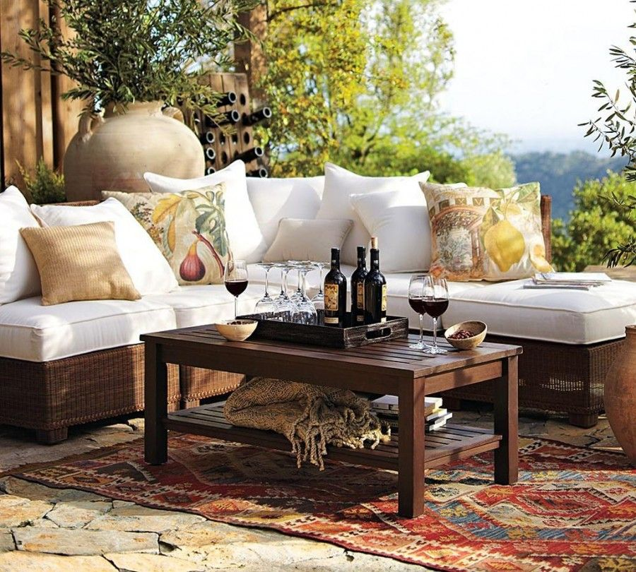 Stunning-White-Sectional-Sofa-of-Rustic-Outdoor-Furniture-Facing-Wicker-Base-and-Wooden-Table