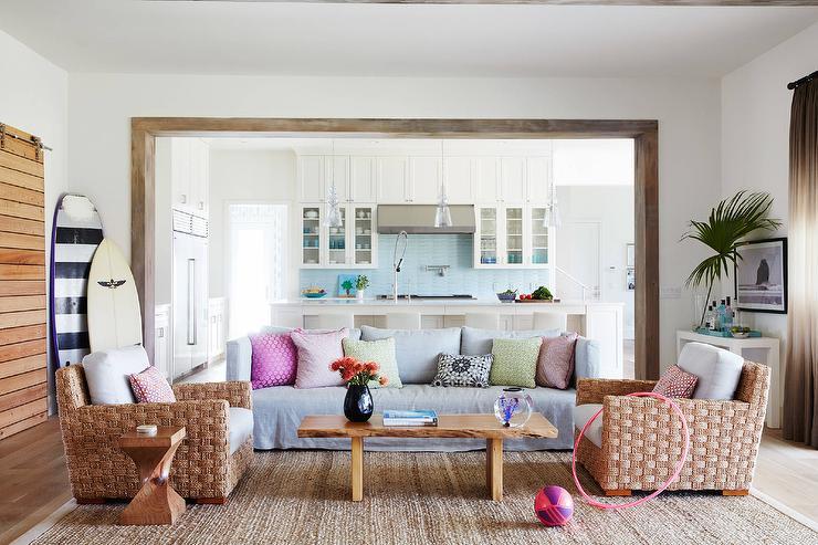 beach-living-room-gray-slipcovered-sofa-live-edge-coffee-table