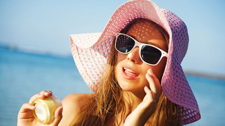 woman-wearing-hat-and-sunglasses