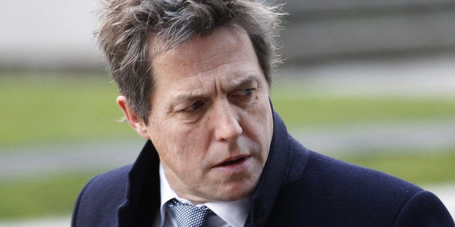 British actor Hugh Grant, who testified to the Leveson Inquiry, arrives at the Queen Elizabeth II Conference Centre in London where Lord Justice Brian Leveson is to release his report, after a year long inquiry, into the culture and practices of the British press and his recommendations for future regulation to prevent phone hacking, data theft, bribery and other abuses, Thursday, Nov. 29, 2012. (AP Photo/Sang Tan)