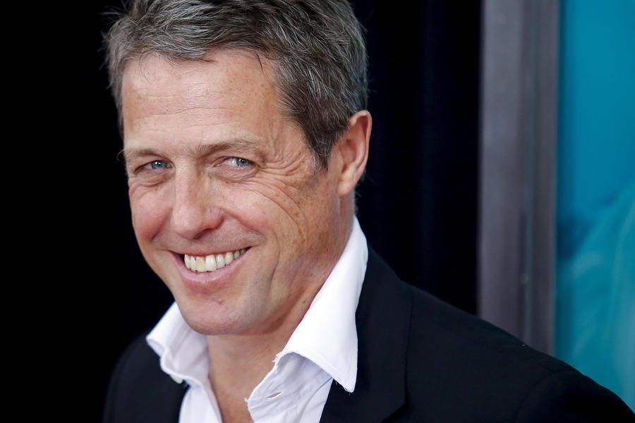 "11 Aug 2015, New York City, New York State, USA --- Actor Hugh Grant attends the premiere of ""The Man From U.N.C.L.E."" at Ziegfeld Theater in New York August 10, 2015. REUTERS/Eduardo Munoz --- Image by © EDUARDO MUNOZ/Reuters/Corbis"