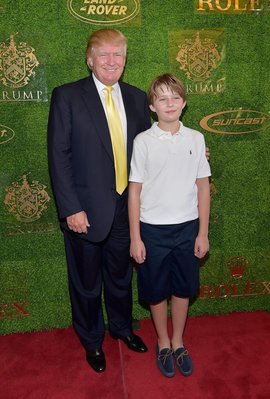 PALM BEACH, FL - JANUARY 04: Donald Trump and Barron Trump attends Trump Invitational Grand Prix Mar-a-Lago Club at The Mar-a-Largo Club on January 4, 2015 in Palm Beach, Florida. (Photo by Gustavo Caballero/Getty Images)