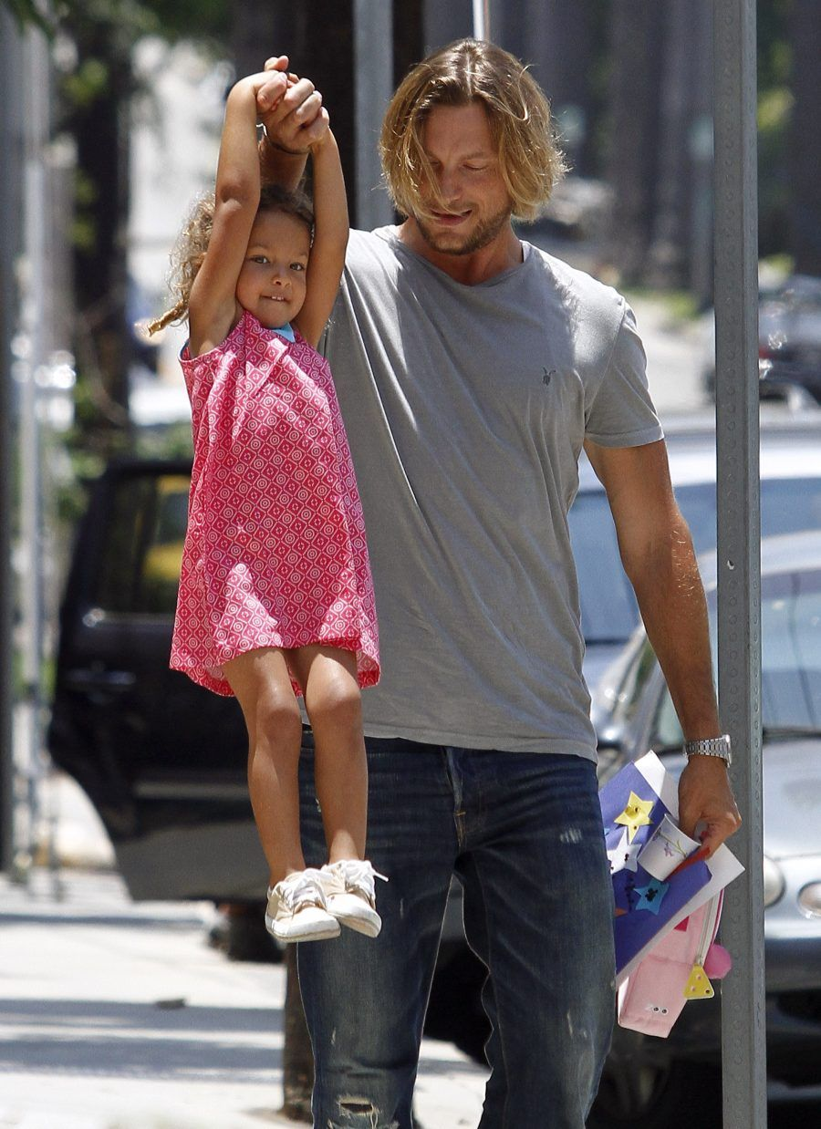 #7573189 Gabriel Aubry, ex of actress Halle Berry, was all smiles as he pick up his daughter Nahla on July 8, 2011 from a local recreational center in Los Angeles, California. Nahla looked to be having a blast using her father's arm for amusement as they walked to the car. Aubry and Berry are currently battling over a violation in the custody agreement the two have made when Halle's lawyer submitted document to the courts saying the model put their daughter at risk. The court date was set back after Aubry failed to appear on June 28, 2011. Fame Pictures, Inc - Santa Monica, CA, USA - +1 (310) 395-0500