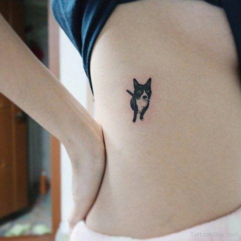 Tatuaggio dedicato ai cani piccolo sul fianco