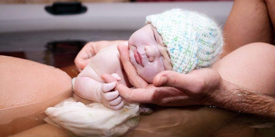 Brand new baby born via natural home water birth