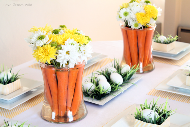 Centrotavola di Pasqua con fiori, uova e carote